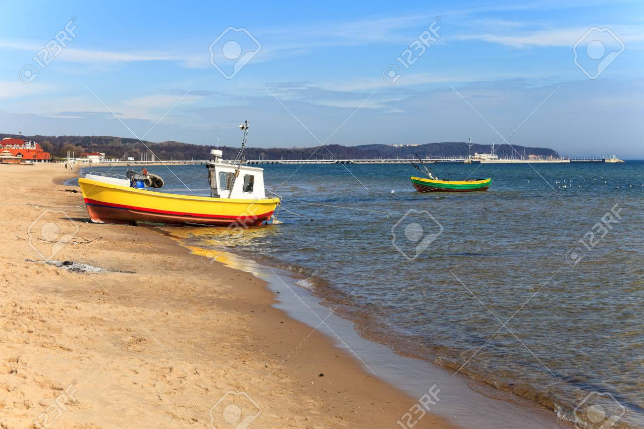 Fishing boats on the background of the pier in Sopot, Poland. Stock Photo - 13456021