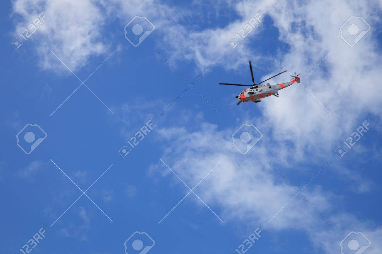 Helicopter rescue in flight against blue sky background Stock Photo - 14018289
