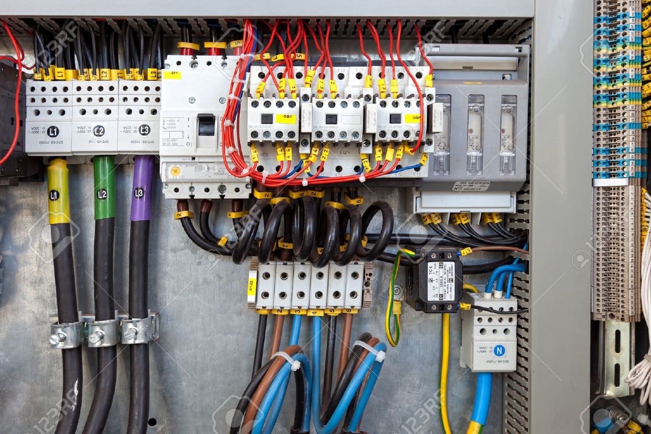 Electrical panel at a assembly line factory Controls and switches - 16576794
