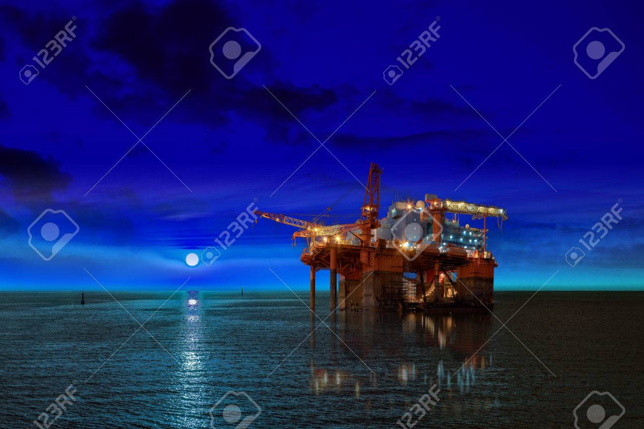 Oil Rig at night time and the moon. - 33363796