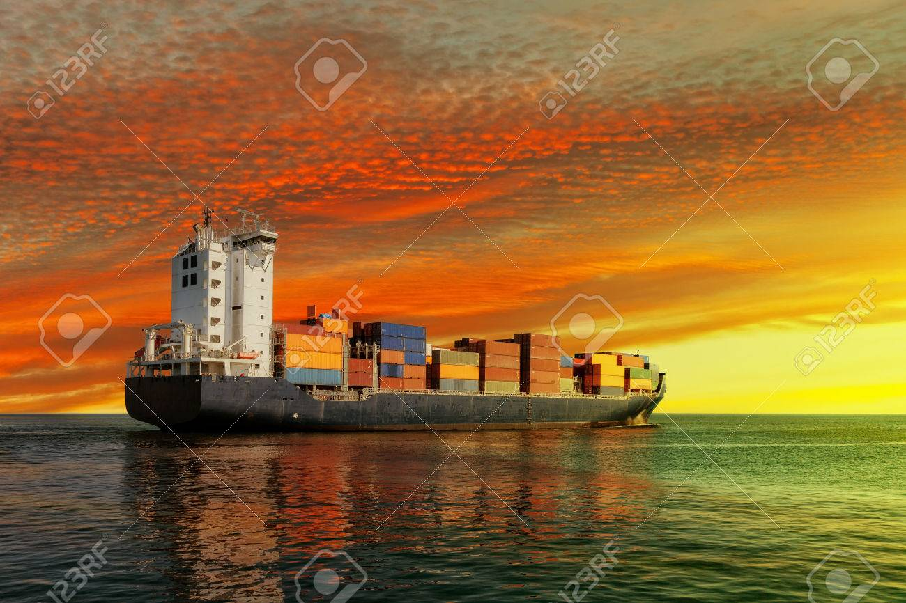 Container ship at sunset in the sea. - 35225695