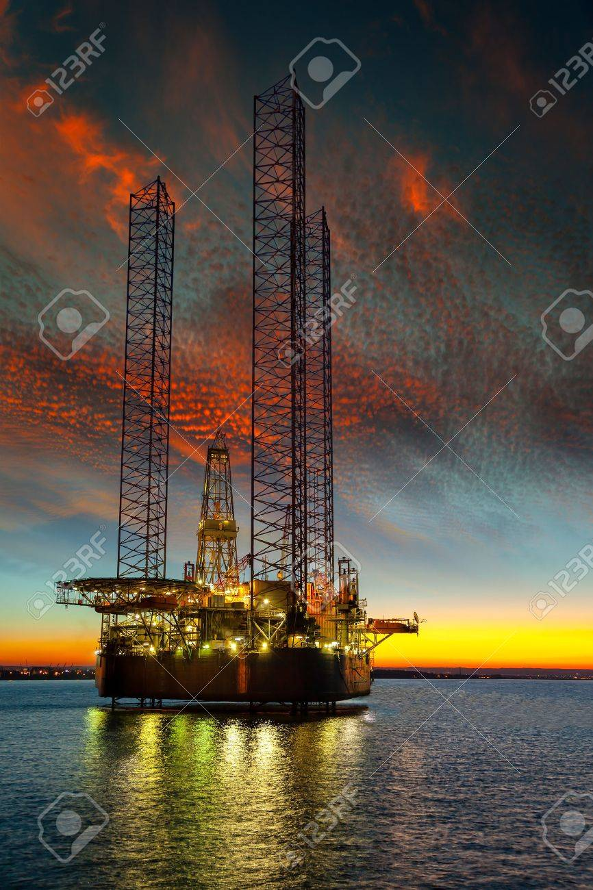 Oil drilling rig in sunset time. - 35226364