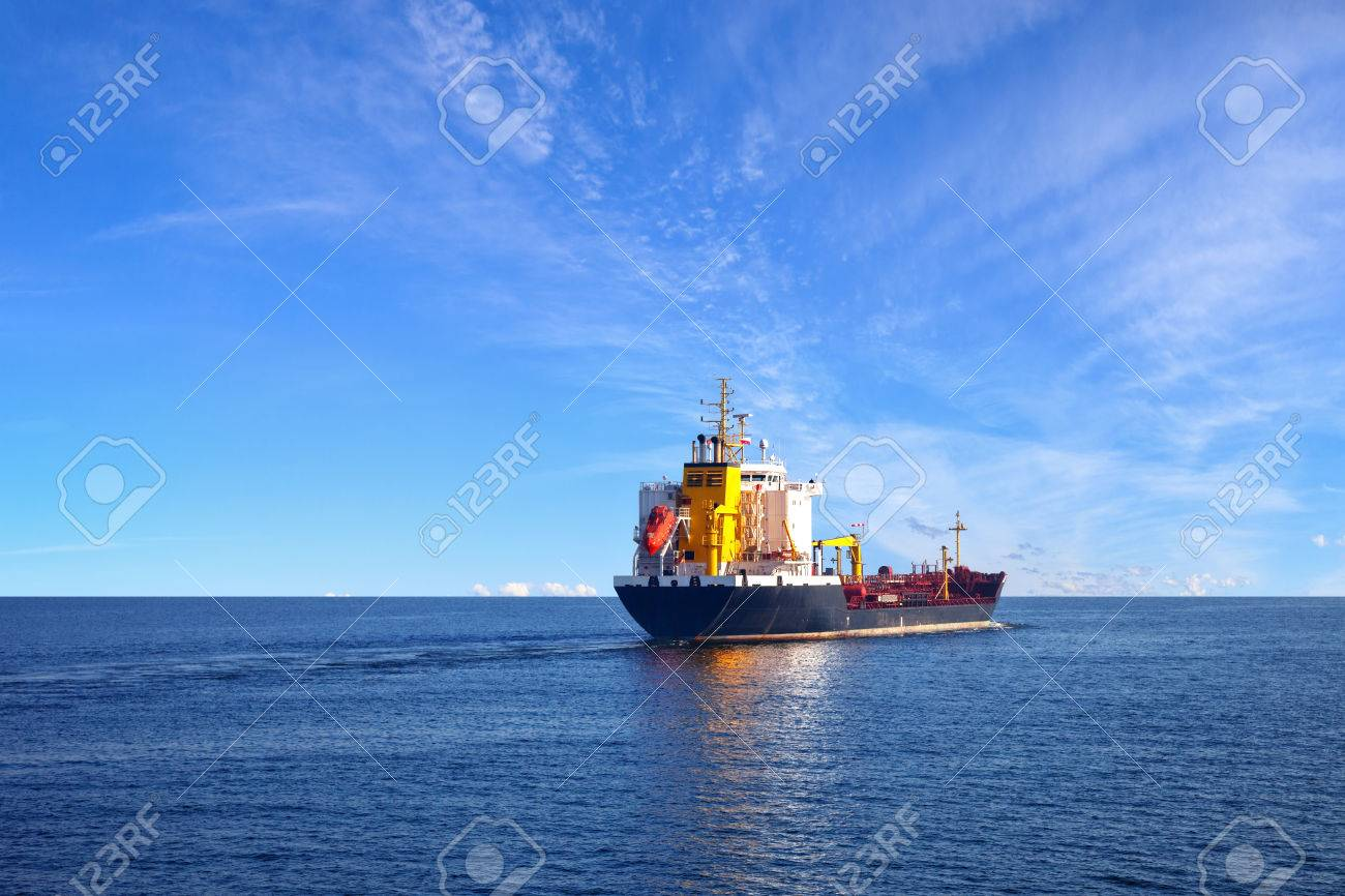 Oil tanker ship at sea on a background of blue sky. - 37240393