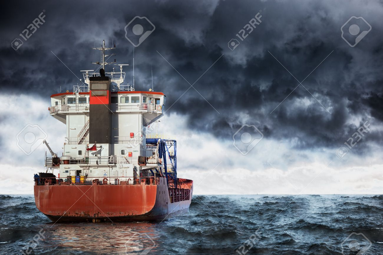 Cargo ship at sea during a storm. - 45531515