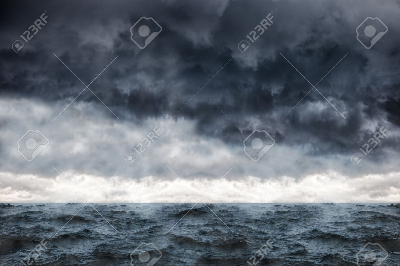 Dark clouds in the winter sky during a storm at sea. - 46073405