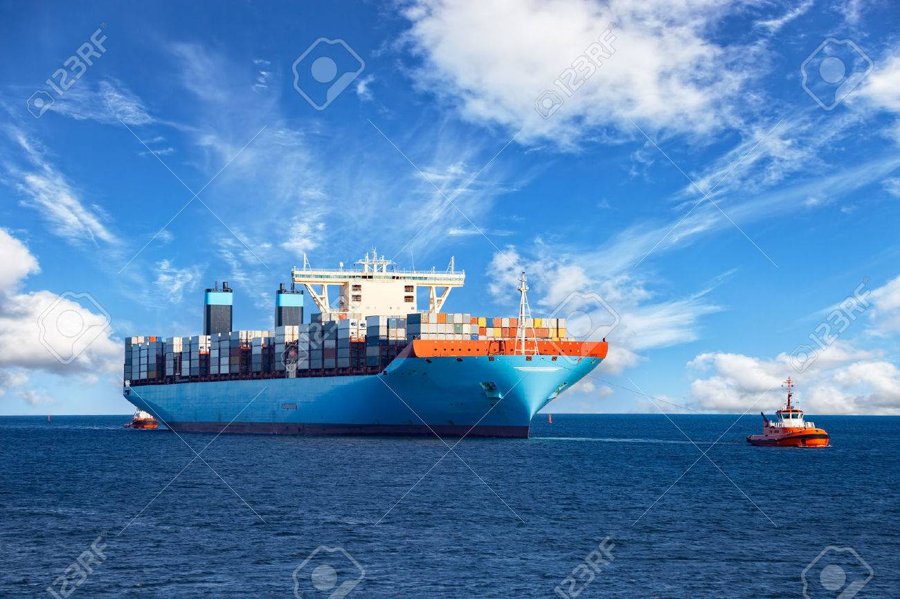 Tugboats assisting container cargo ship to harbor. - 46952621