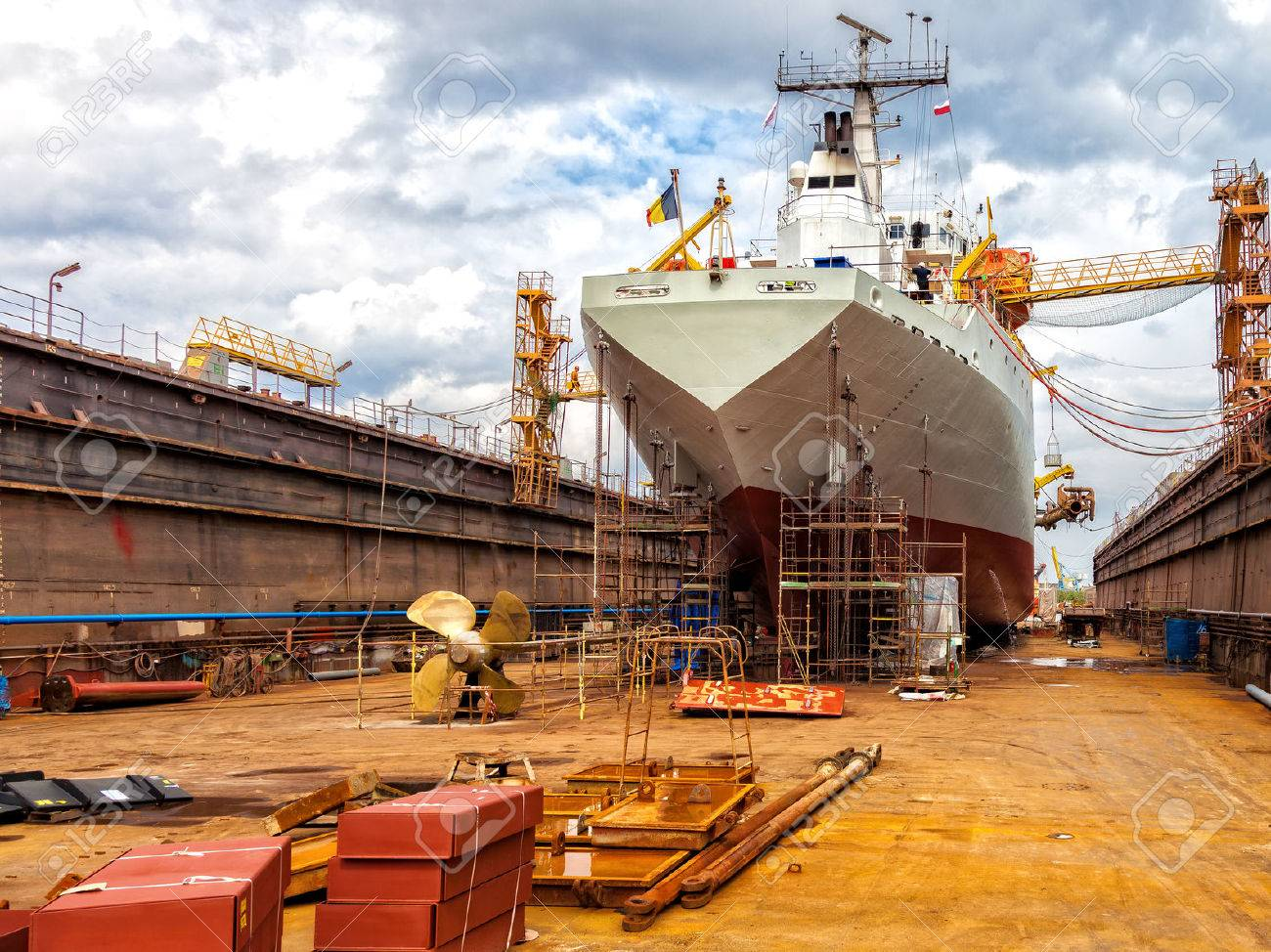 Big ship - rear view with propeller under repair. - 57187837