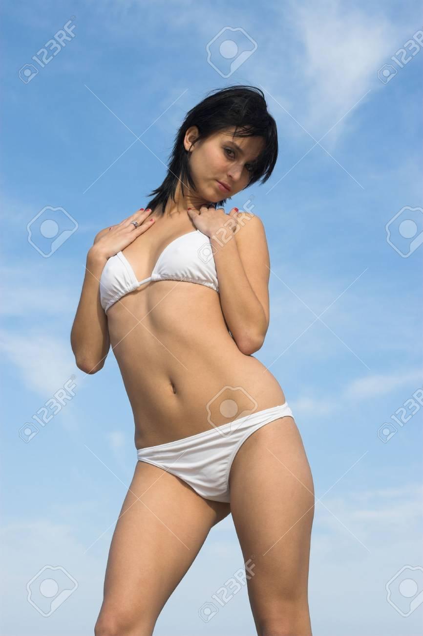 Stunning young lady posing in white bikini Stock Photo - 596366