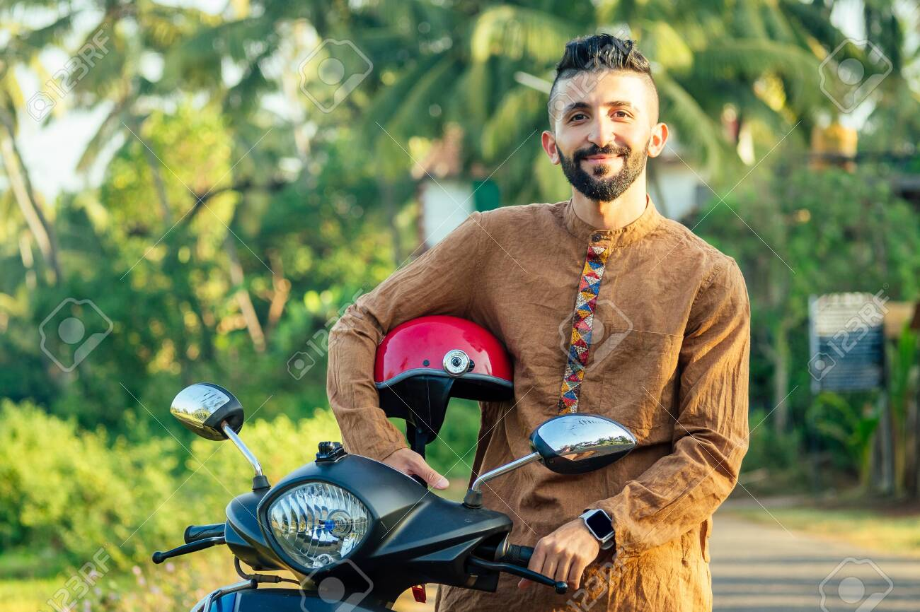 indian man wear helmet and ready to driving explore india attractions of Goa - 144609328