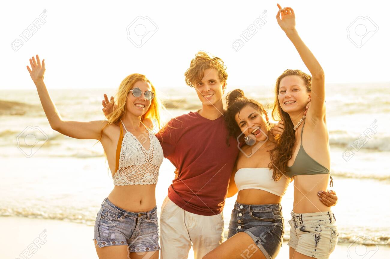 Multi-ethnic group of friends dance at the beach - 146046652