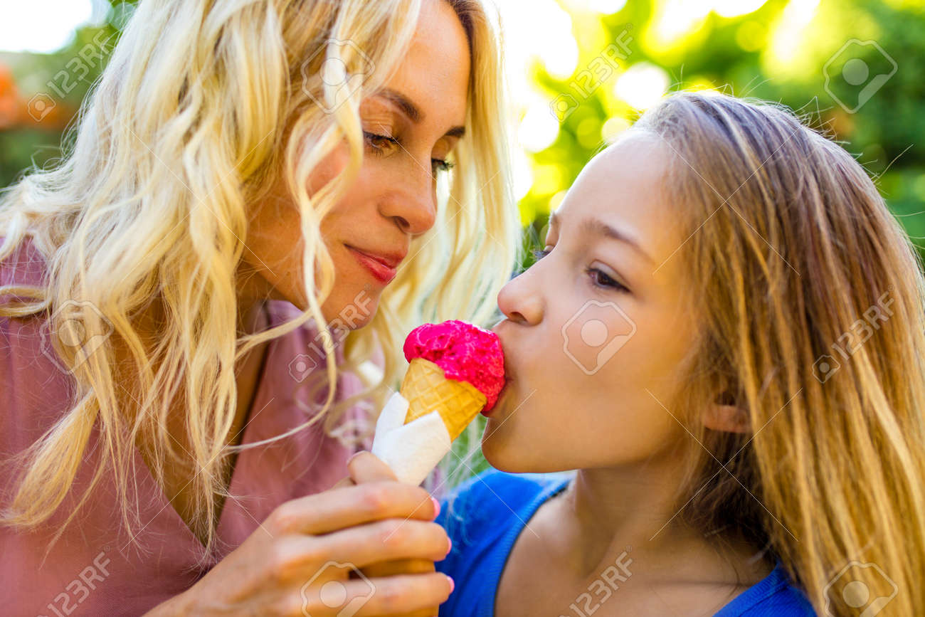 blonde mom and her cute child in summer beach seaside in tropics - 157297163