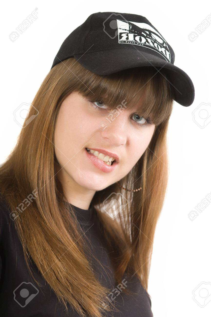 The young beautiful girl in a black T-shirt and a black cap on a white background. Isolated Stock Photo - 6101475