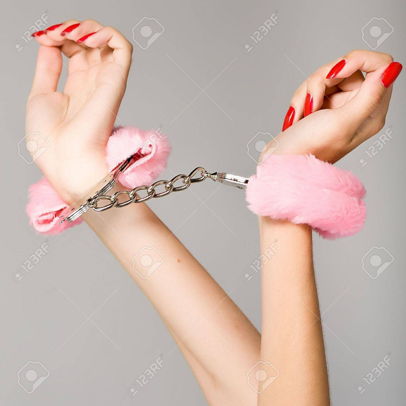 Female hands in handcuffs Stock Photo - 12336248