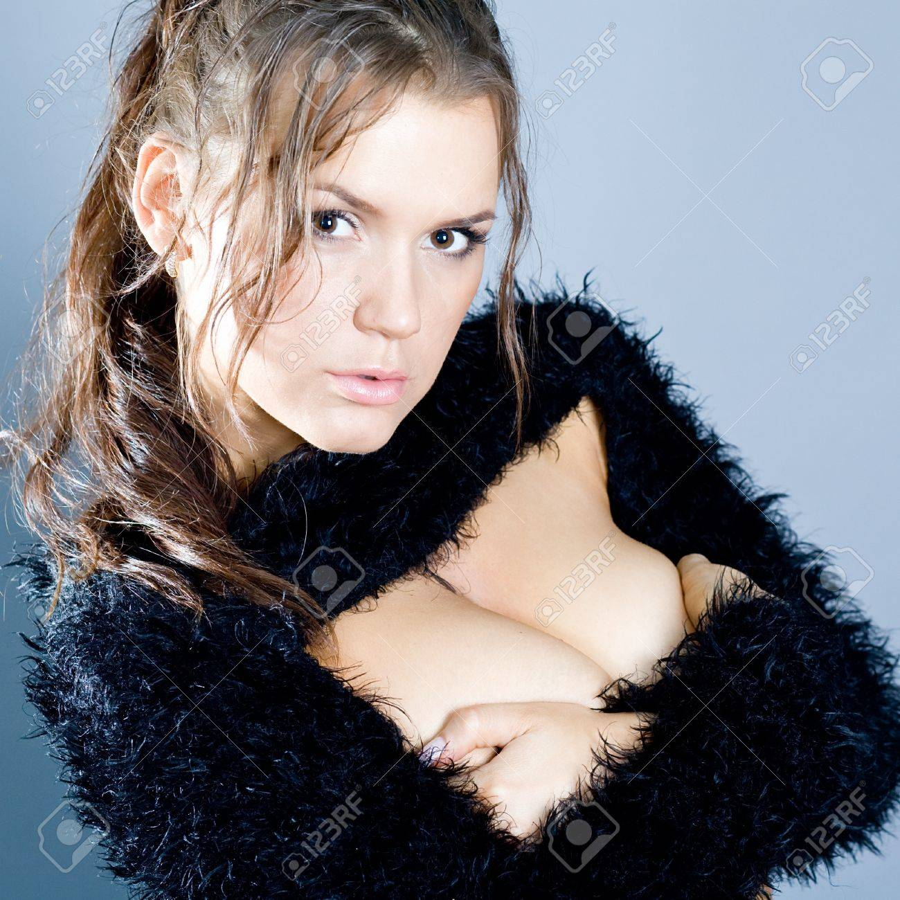 Portrait of the young beautiful brunette Stock Photo - 12568853