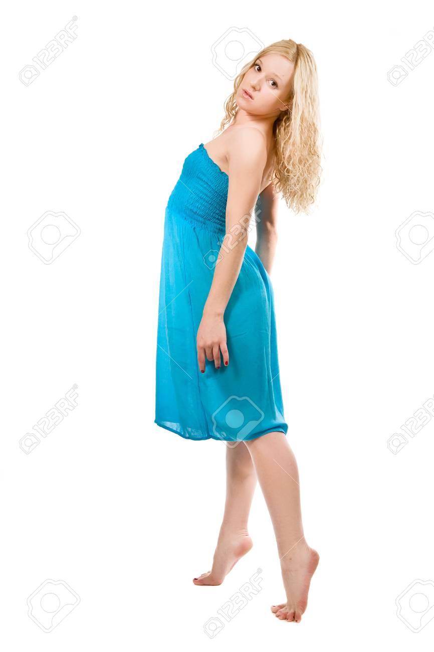 2f4001469 Niña en un hermoso vestido azul oscuro aislado en blanco Foto de archivo -  12775105