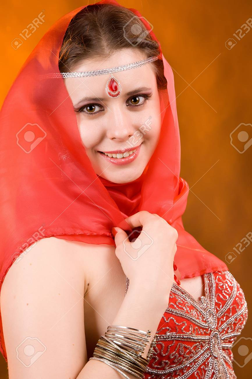 Portrait of the woman in a red scarf Stock Photo - 13451195