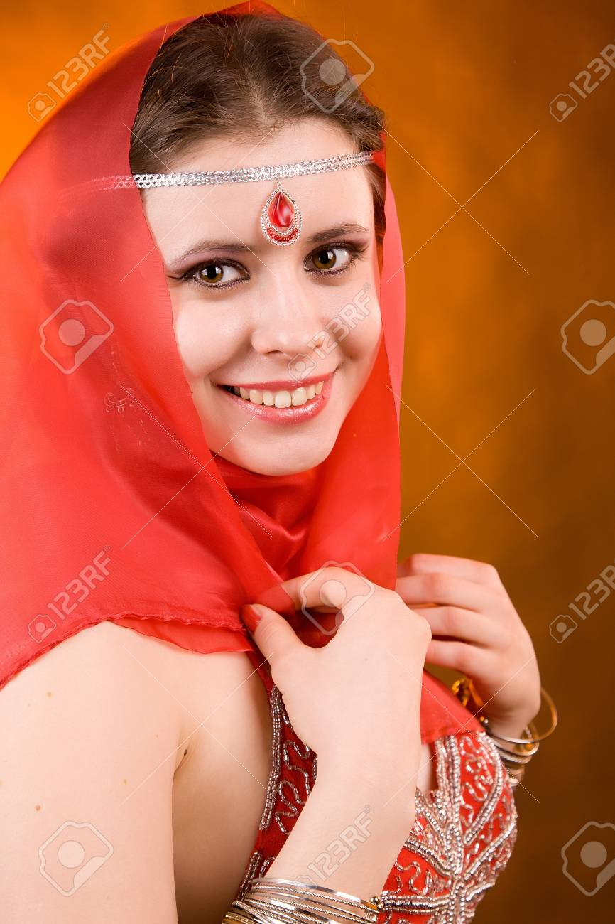 Portrait of the woman in a red scarf Stock Photo - 13451190