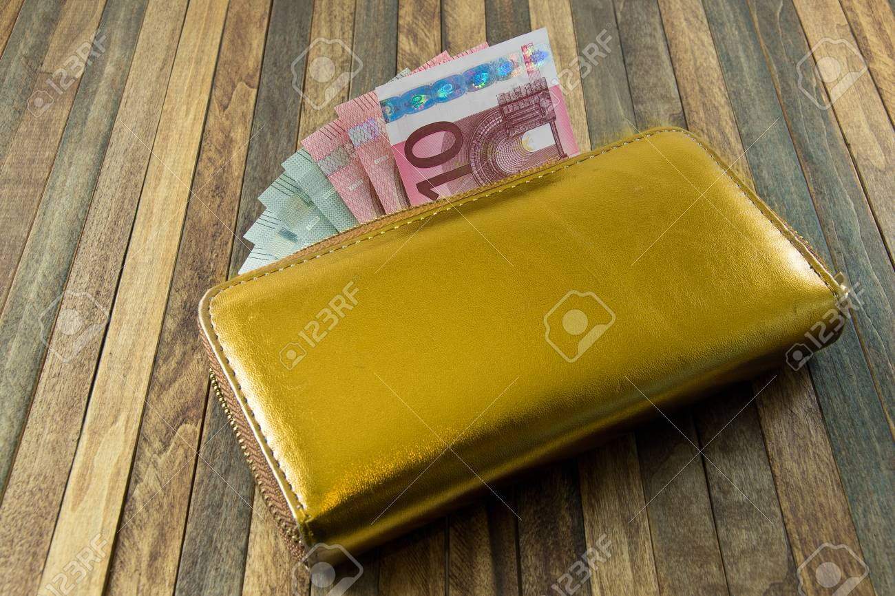 Women s Money Purse With Gold Color On Wooden Background Stock Photo ... 8a1b7b46d4