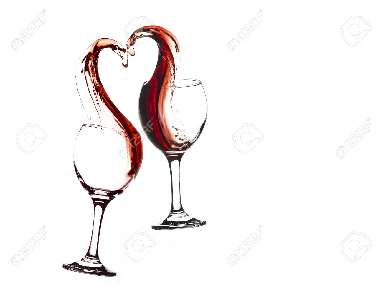 e1b4c06806e9 Two glasses of red wine with abstract heart splash on a white background  Stock Photo -