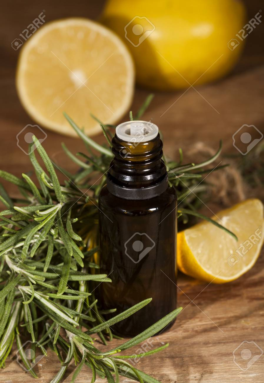 Lemon Essential Oil Lemon Fruit And Rosemary On Wooden Background Stock Photo Picture And Royalty Free Image Image 50273262