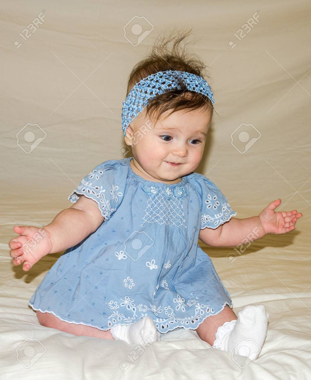 4a5bc3b8d Portrait Of The Beautiful Sweet Little Baby Girl In A Blue Dress ...