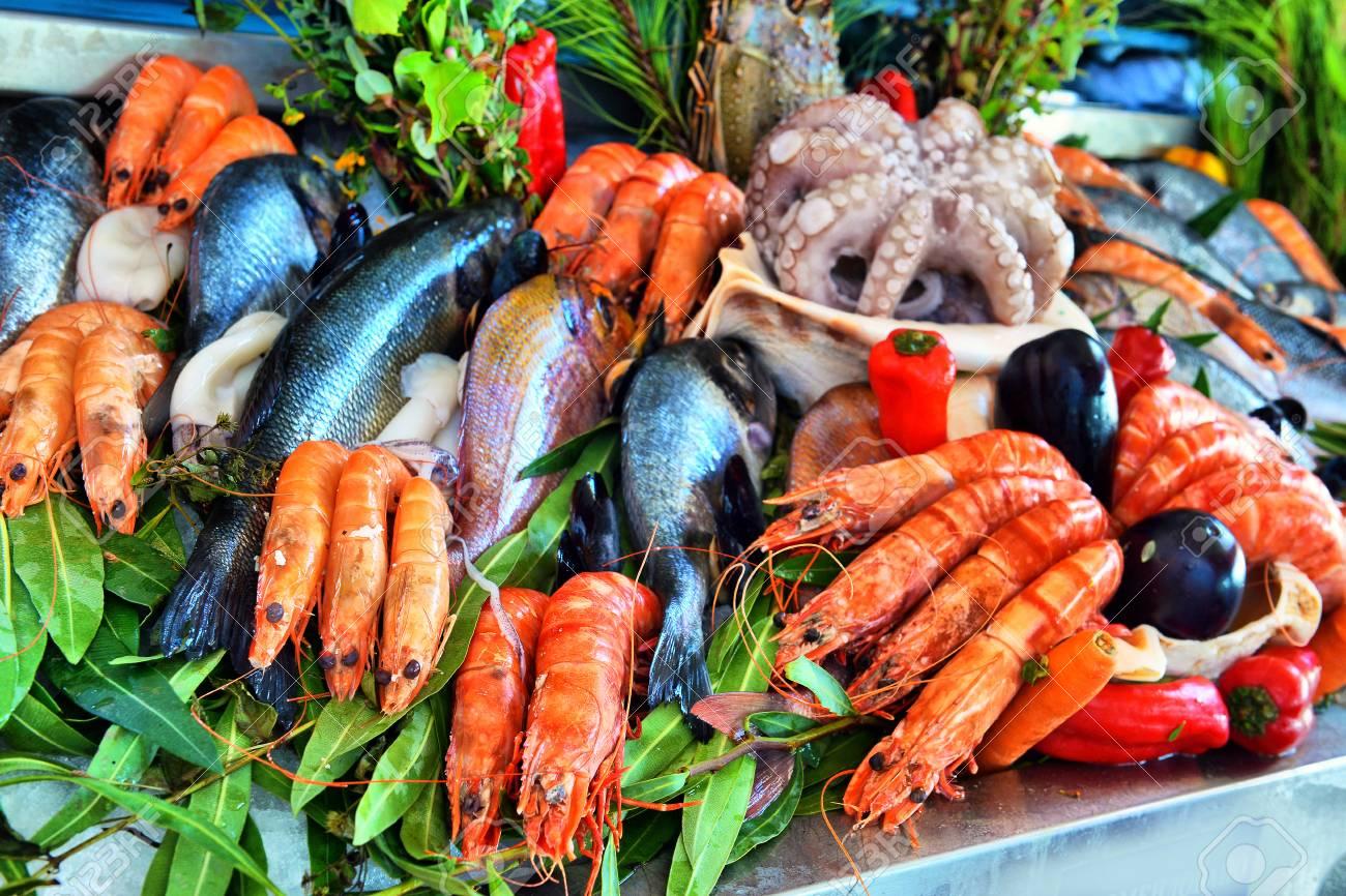 Sale of fresh frozen arranged fish on ice in farmer's bazaar