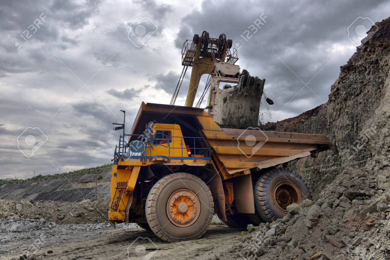 Large quarry dump truck  Loading the rock in the dumper  Loading
