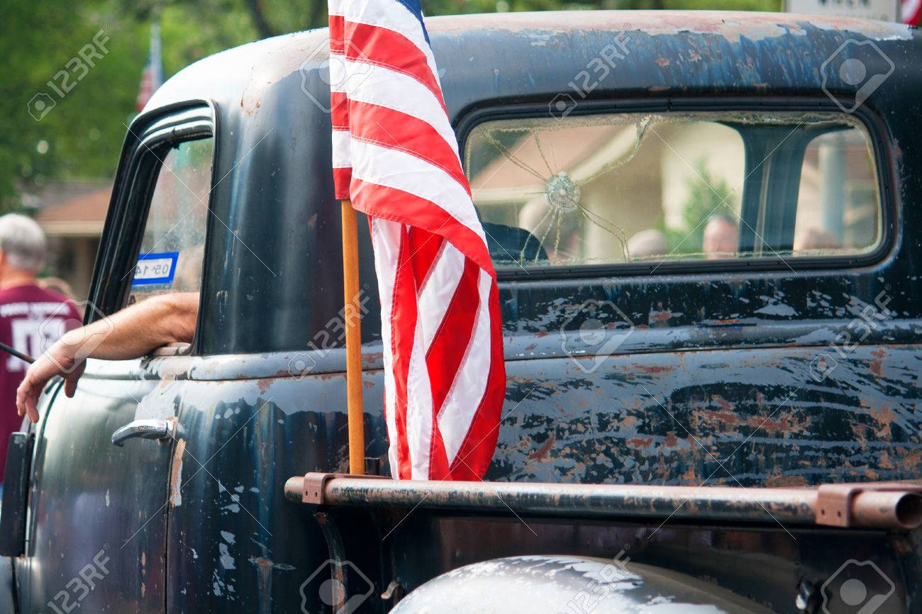 An American Flag Is Attached To The Back Of An Old Beat Up Pickup Stock Photo Picture And Royalty Free Image Image 72311989