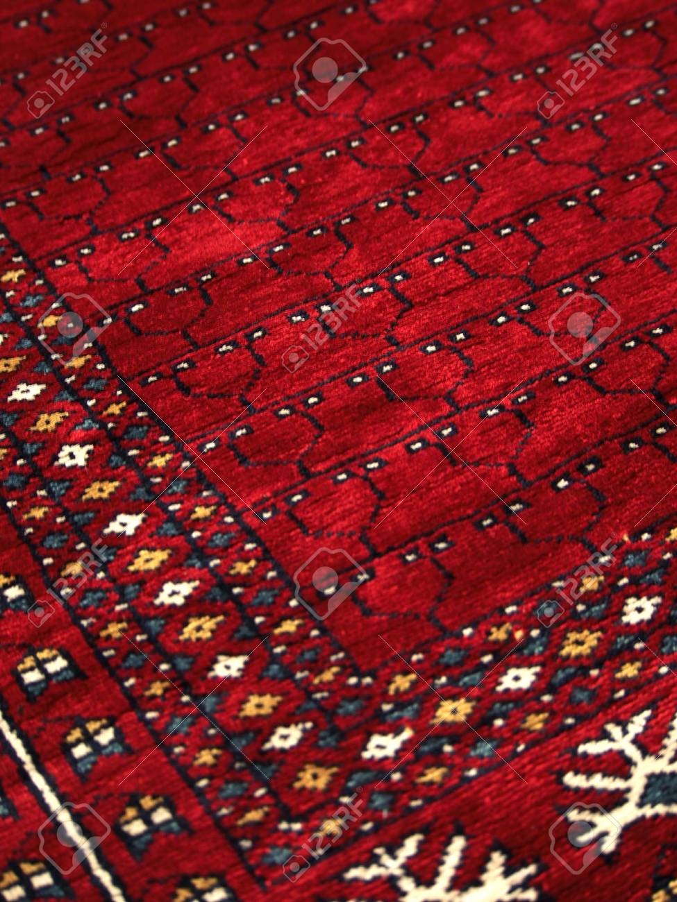 Detail Of A Rich Patterned Handmade Indian Rug Stock Photo
