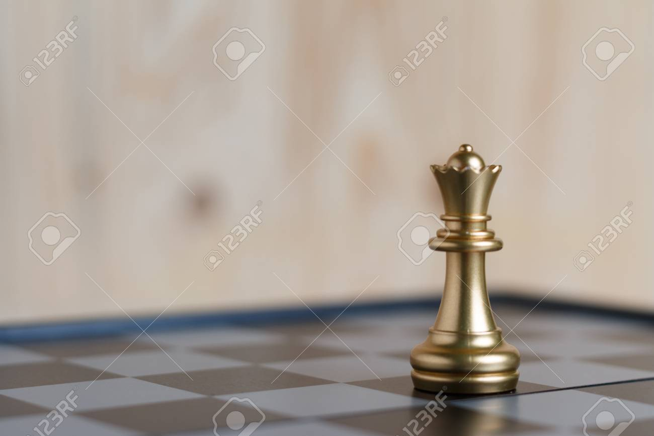 The gold queen chess set on board is located. Select focus shallow depth of field and blurred background. Concept work - 101131867