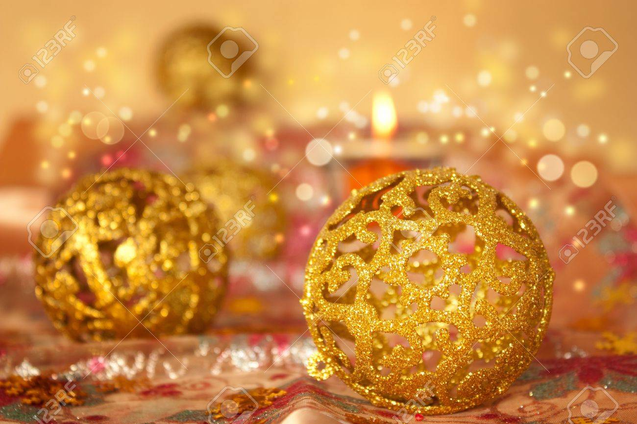 Golden Christmas ornaments on glitter tablecloth. Stock Photo - 10635153