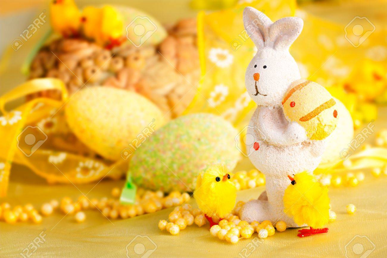 Easter setting with Easter eggs, chicks and rabbit. Stock Photo - 11227535