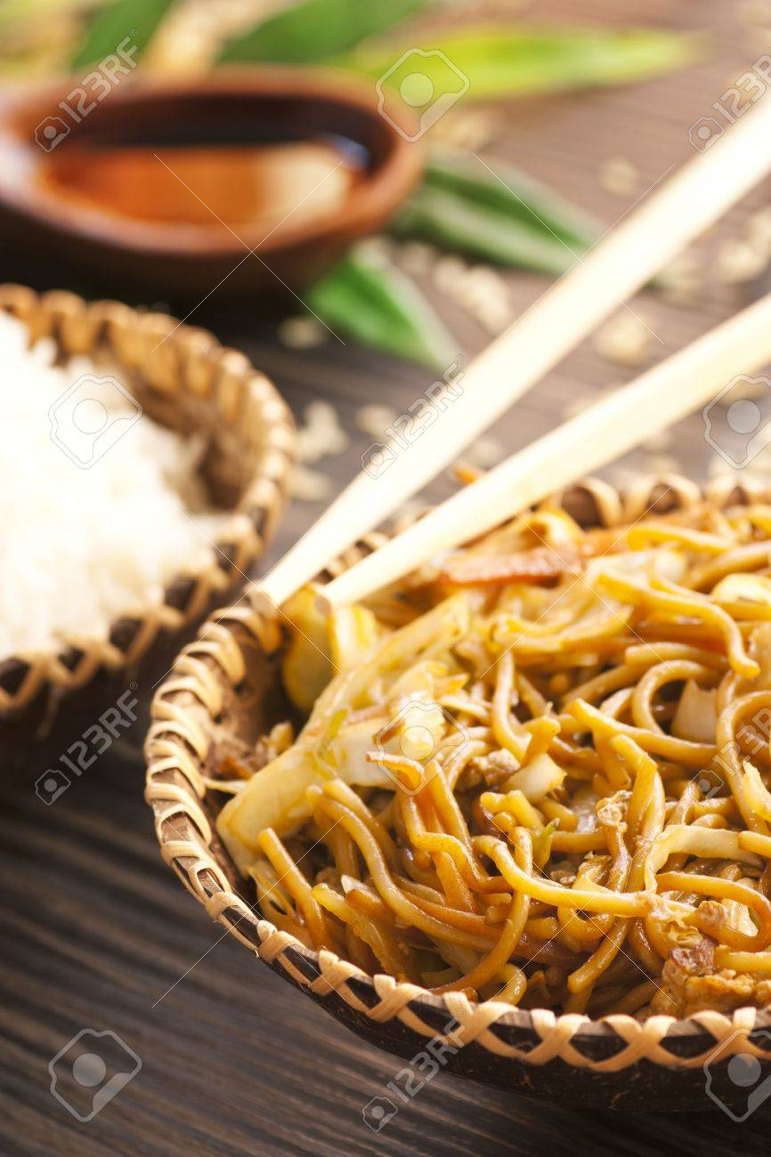 Egg Noodles With Chicken And Vegetables Steamed Rice And Soy Sauce