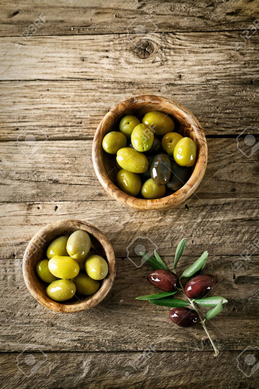 olives on old wood. Wooden table with olives and olive oil - 42140219