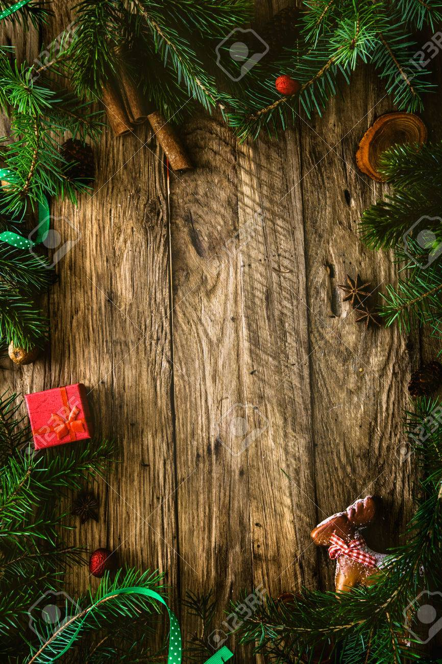 Christmas background.Xmas wreath card with with copyspace on wooden background. Christmas ornaments on wood with candy and ribbons. - 46774903