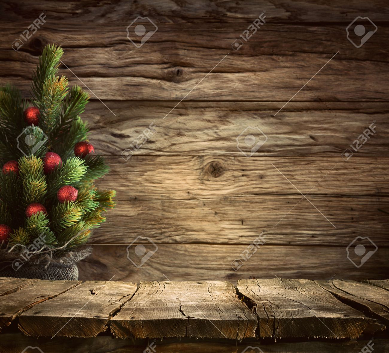 Christmas background. Empty table for your montage. Xmass tree on wood. Space for text - 48977427