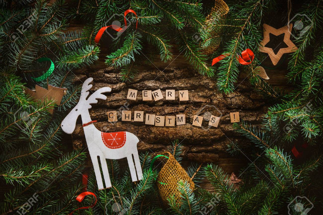 Merry Christmas. Christmas greeting card with rustic wood and ornaments. Xmas backgroud. - 48977452