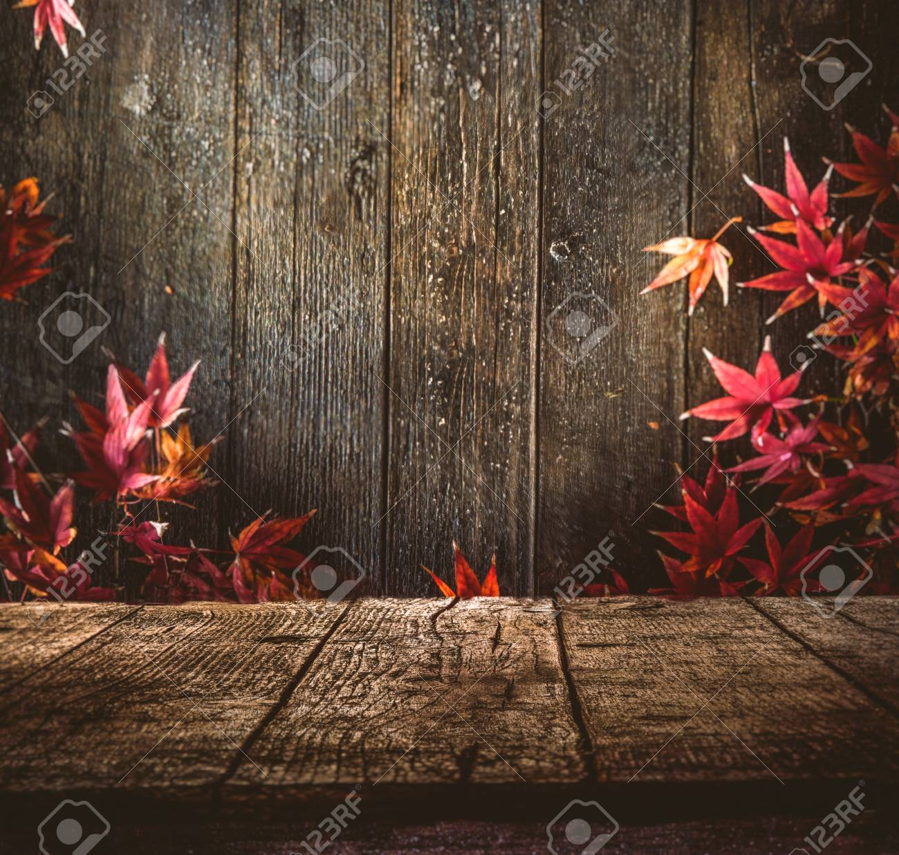 Wooden table. Autumn design with leaves and empty display. Space for your montage. Season fall background - 61520725