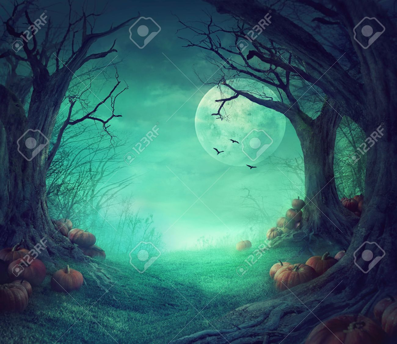 Halloween background. Spooky forest with dead trees and pumpkins. Halloween design with pumpkins - 63075673