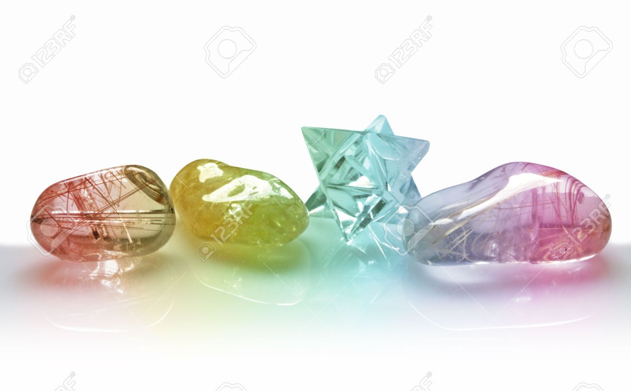 Four Rainbow Coloured Quartz Crystals on white background Stock Photo - 28174297