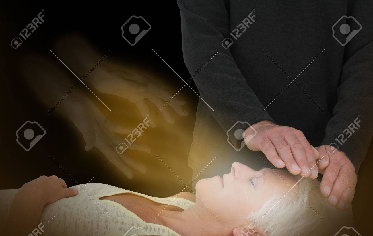 Spiritual Healing Session - male healer channeling healing energy to female with the help of a spirit healing guide - 54639695