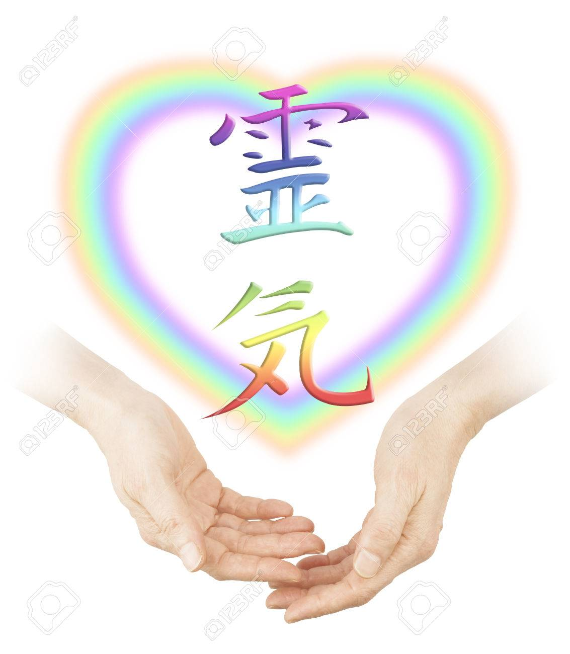 Sharing reiki healing female cupped hands with a soft focus sharing reiki healing female cupped hands with a soft focus heart shaped rainbow and a buycottarizona Image collections