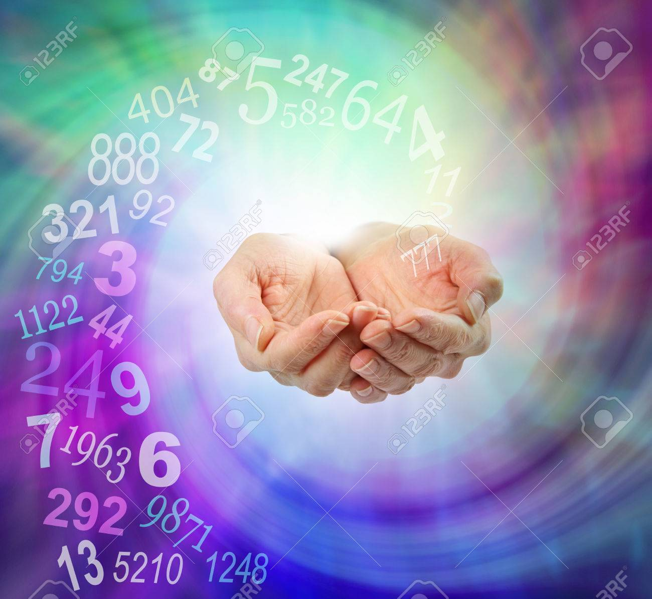Ask a Numerologist for guidance - female cupped hands emerging from an ethereal multicolored spiraling energy field and a swirl of random numbers coming into her hands with copy space - 56095792