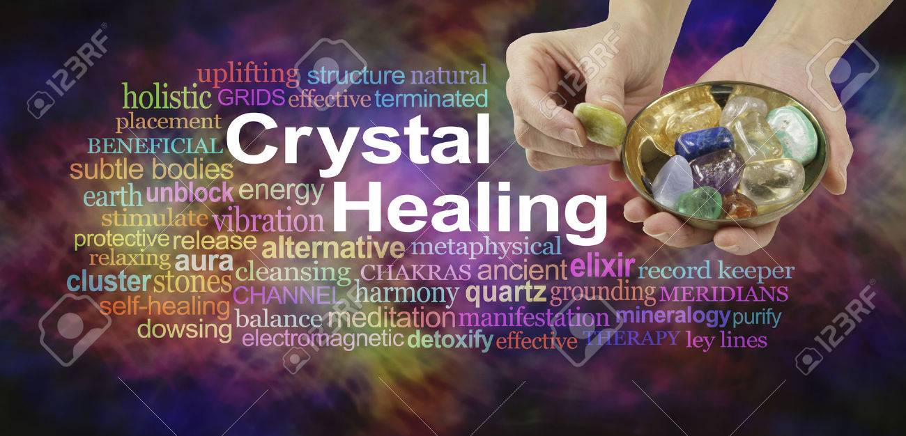 Crystal healing word cloud - female crystal therapist offering yellow stone from a selection of crystals in a brass dish, surrounded by a relevant word cloud on a vibrant multicolored background - 62352476