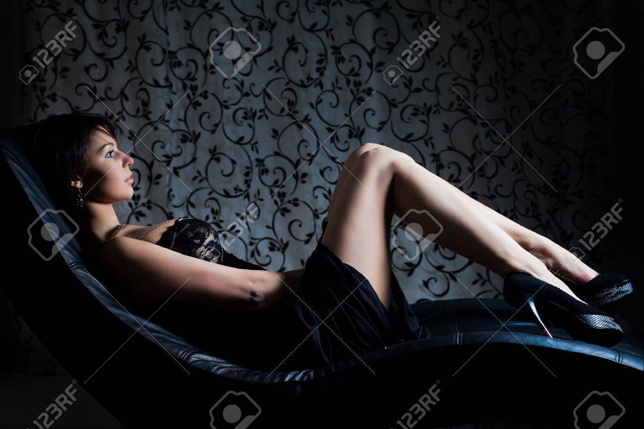 sexy girl in evening dress lying on the sofa Stock Photo - 18174307