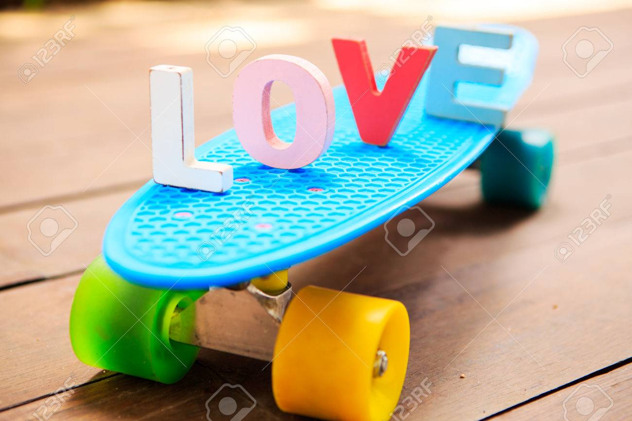 Word Love Made Up Of Colorful Wooden Letters On The Blue Penny
