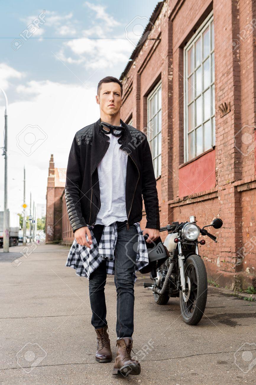 Handsome Rider Biker Man In Black Leather Jacket Jeans And Helmet