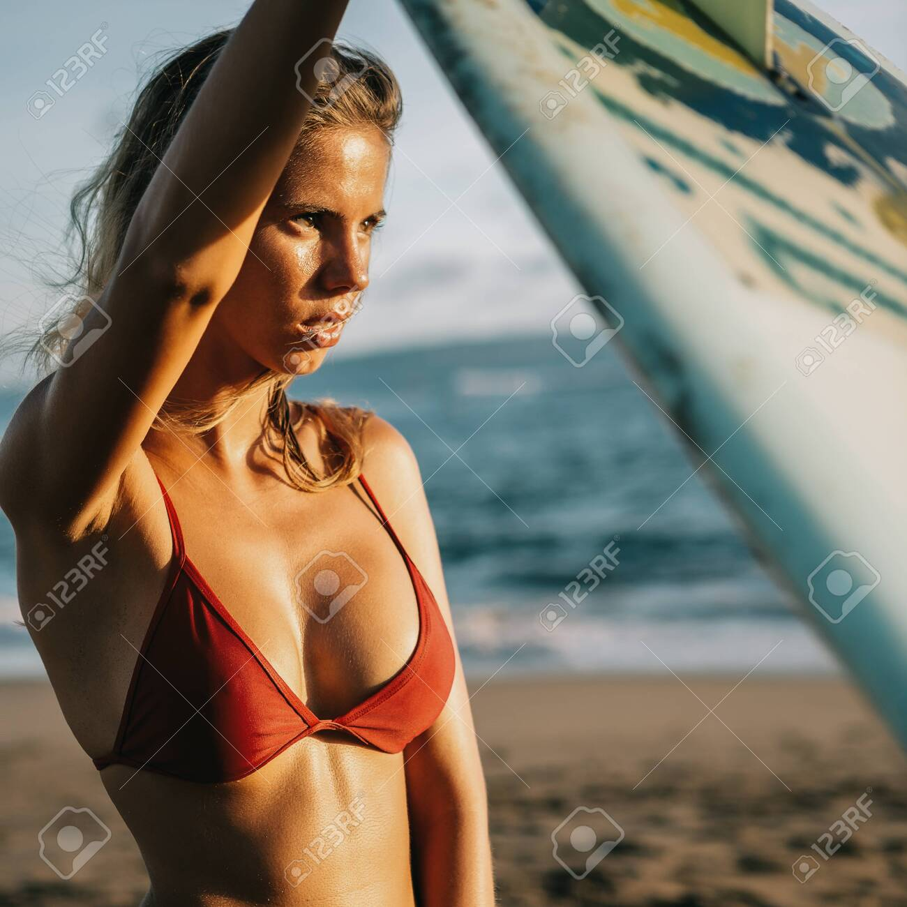Young Fit Surfer Girl In Sexy Red Bikini With Surfing Longboard