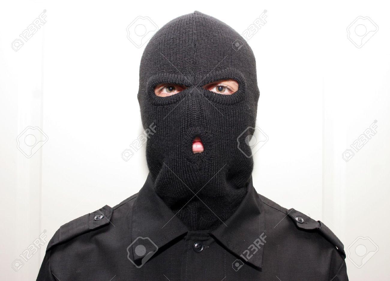 an burglar wearing a ski mask (balaclava) Stock Photo - 4483452 f6e5fed74cc