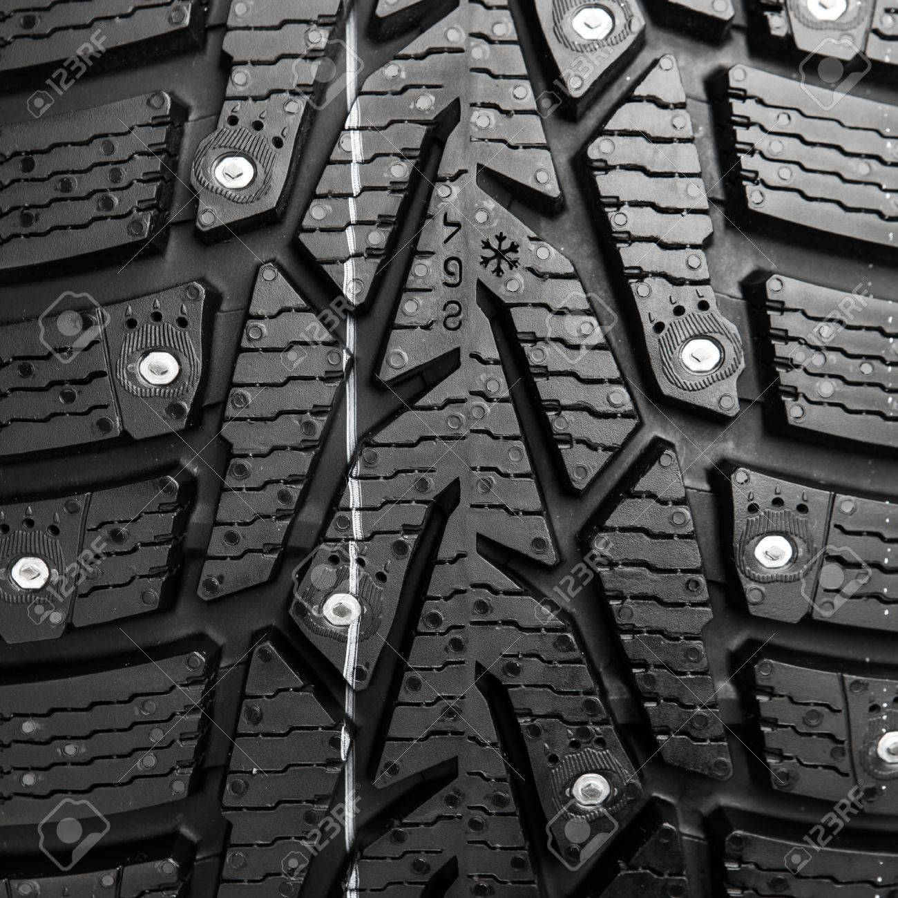 protector and snow spikes of winter tire Stock Photo - 17036057